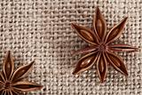 anis star on burlap canvas background, close-up