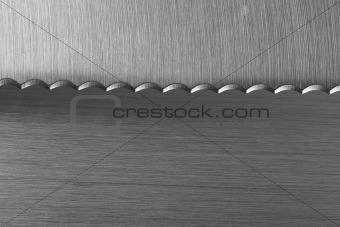 Serrated Bread Kitchen Knife on brashed stainless background