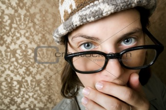 Nerdy Woman in a Knit Cap Covering Her Face