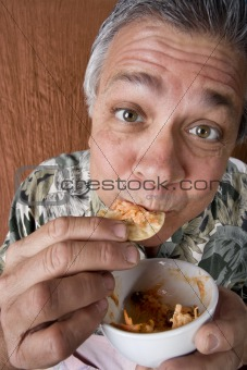 Man Eating Chips and Dip