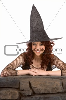 Smiling read head teen girl in Halloween hat