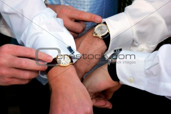 Businessmen checking time