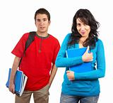 Two students with books and backpacks