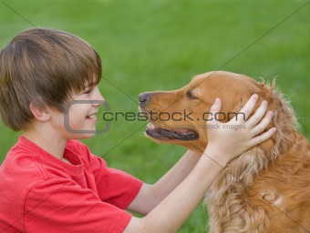 Boy Playing with His Dog