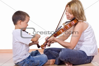 Boy and woman practicing the violin