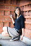 Teenager Girl Against Brick Wall