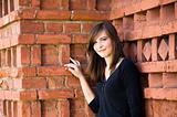 Happy Girl Against Brick Wall