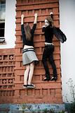 Two Young Girls On The Wall