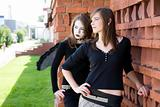 Two Girls Near A Brick Wall