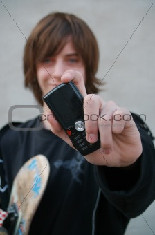 Skater teen boy with cellphone