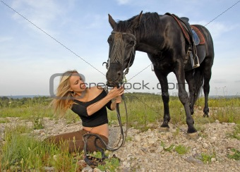 teenager and black stallion in nature